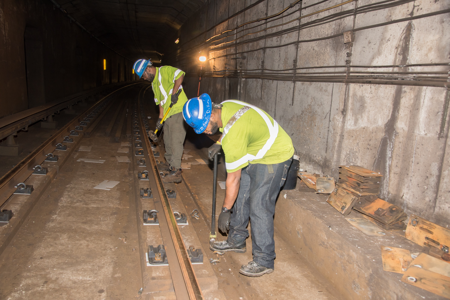 workers replacing rail fasteners