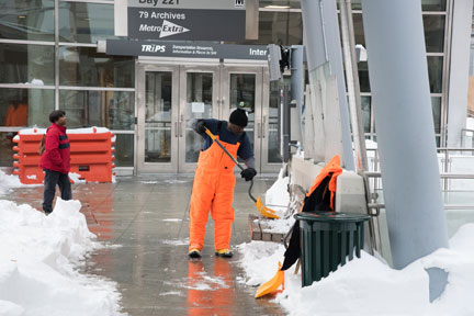 Clearing snow from a bus stop