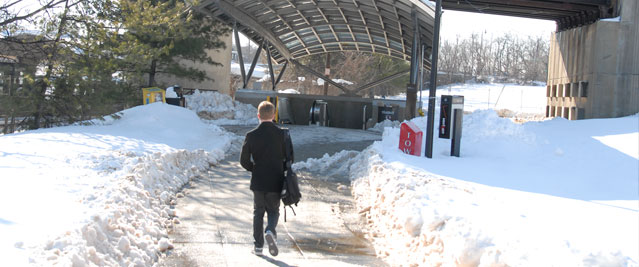 Person walking to Metro station in the snow