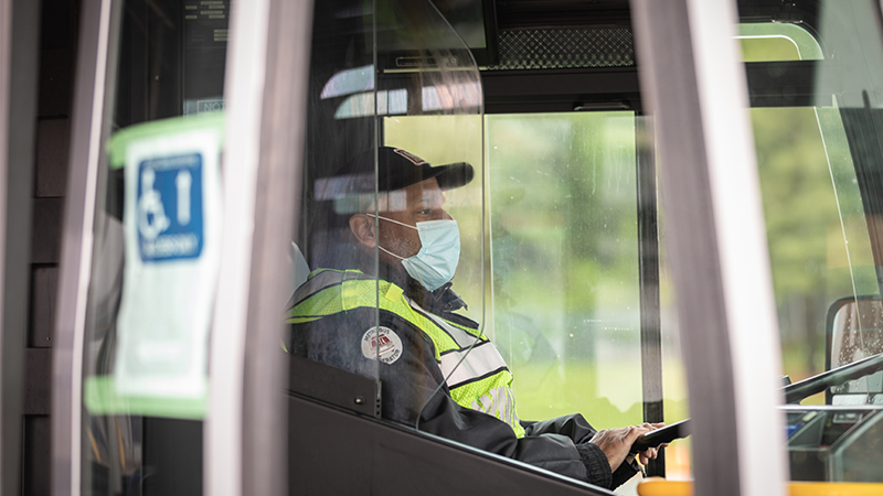 Bus operator wearing a face covering