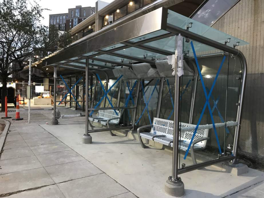 Eisenhower Ave – windscreens and benches are set along the permanent bus loop